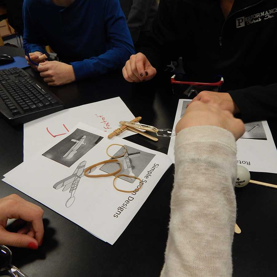 Students were given a packet of catapult designs, and worked together to recreate these designs using specific materials, such as popsicle sticks and rubber bands.